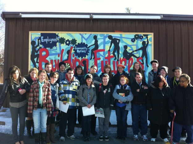 Sackville High Grade 12 Class in front of their mural at Anchor Industries Society